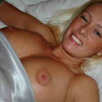Silver Dress - Large Breasts, Nipple Slip , Silver Dress, Nipple Slip, Large Breasts, Lying In Bed, Topless In Bed, Falling Out Of Dress, Sexy Face, Big Tits In Bed