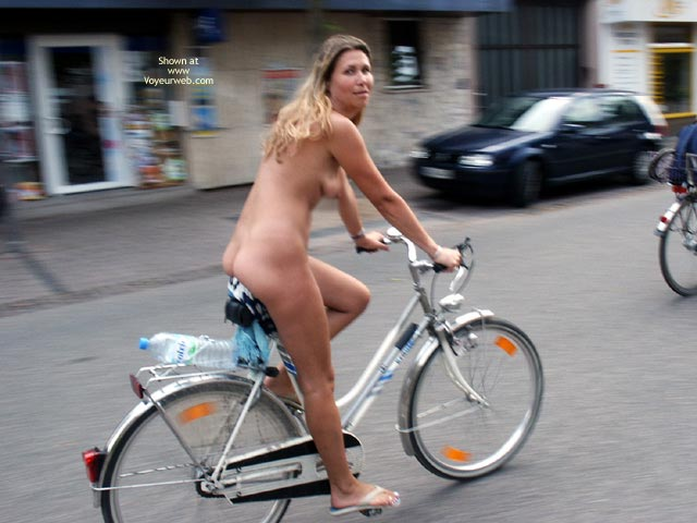 Girl nude on bicycle consider