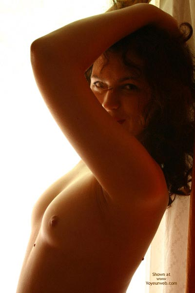 Topless In Window - Curly Hair, Small Boobs, Small Tits, Topless , Topless In Window, Topless, Window, Small Tits, Exposing Armpits, Curly Hair, Arms Above Head, Small Boobs, Smiling Face