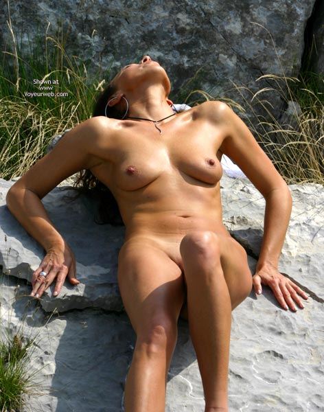 Outdoor Nude - Artistic Nude, Big Nipples, Nude Outdoors, Small Breasts , Outdoor Nude, Artistic Pose, Real Breast, Small Breast, Big Nipples, Tan On The Rocks, Head Back, Pushing Down On Hands, Sunlight Reflecting Of Skin, Large Hoop Earings