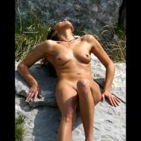 Outdoor Nude - Artistic Nude, Big Nipples, Nude Outdoors, Small Breasts , Outdoor Nude, Artistic Pose, Real Breast, Small Breast, Big Nipples, Tan On The Rocks, Head Back, Pushing Down On Hands, Sunlight Reflecting Of Skin, Large Hoop Earings