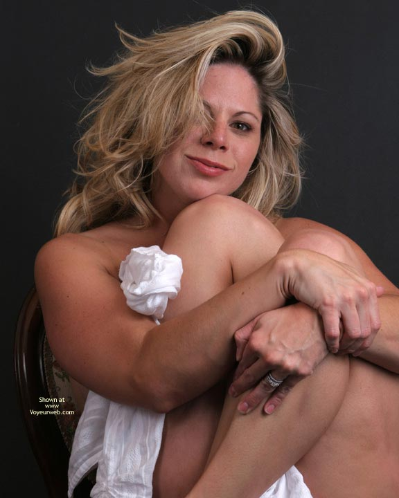 Bed Head , Bed Head, Blonde Milf, Blonde Babe, Clutching A White Wrap, Just Woke Up, Devilish Grin