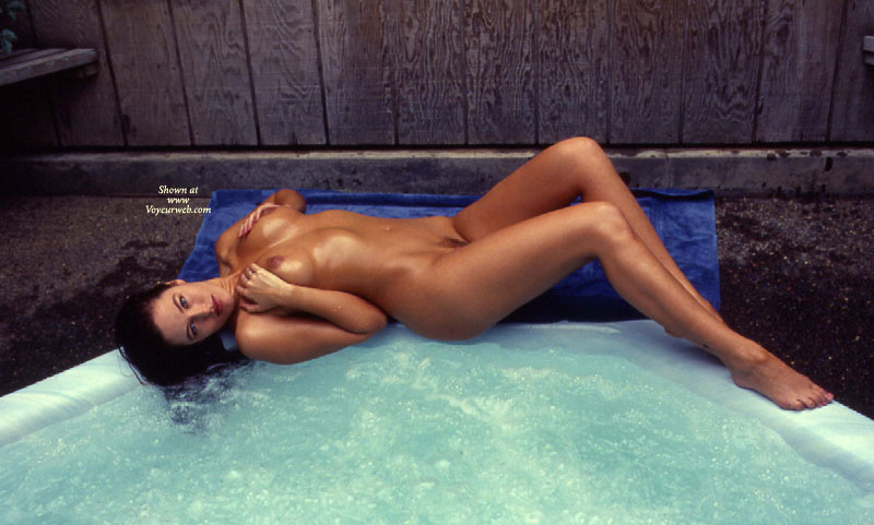 Nude Amateur - Dark Hair, Long Hair, Long Legs, Trimmed Pussy, Naked Girl, Nude Amateur , Hands Covering Breasts Above Nipples, Hot Tub, Long Shapely Legs, Lying Nude On Edge Of Hot Tub, Lying On Back, Sexy Eyes, Wet Skin