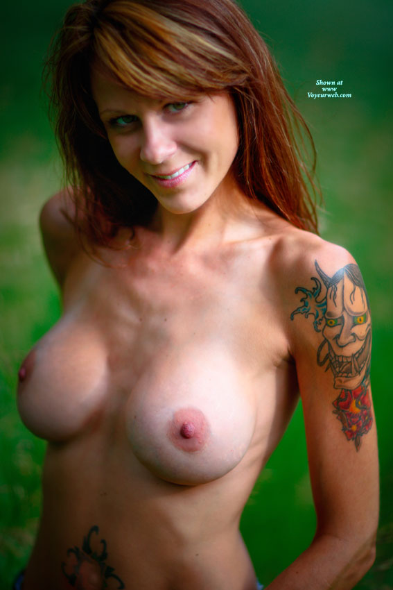 Tits And Tats - Long Hair, Red Hair, Topless , Attractive Smile, Colorful Tatoos, Smiling At Camera, Topless Friend, Tattoo On Arm, Arm Tattoo, Topless Redhead, Long Red Hair, Fetching Smile