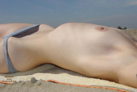 Topless Beach - Close Up, Erect Nipples, Laying Down, Topless Beach , Topless Beach, Blue Bikini Bottom, Laying Down, Erect Nipples, Peeking Out, Small Tities, Beach Close-up, Nude Sunbathing, Streching Out