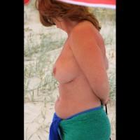 Topless Amateur:Putting On Bikini Top...