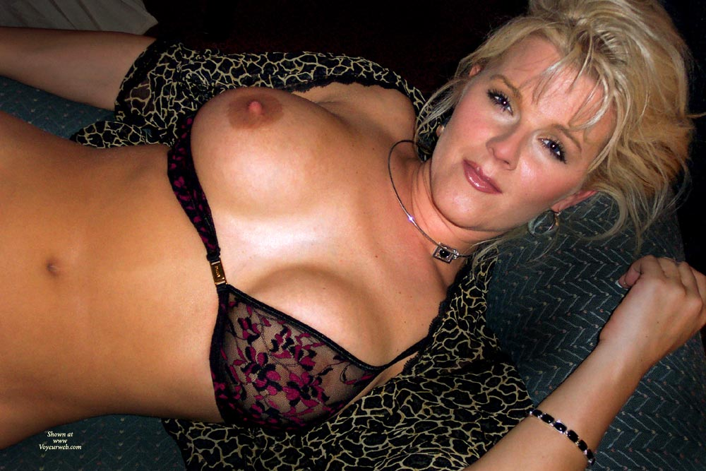 WIfe In Lingerie , Front Fastening Bram Black With Black And Crimson Pattern, Look Into My Eyes, One Arm Bent Upward And One At Her Side, Black See-thru Bra, Nice Bra, Laying Back With Head On Pillow, One Tit Exposed, Wife Photos, Blond, Bold Breasts - Very Fetching, Full Lips, Black Embroidered Sheer Bra, Looking Up With An Amused Smile