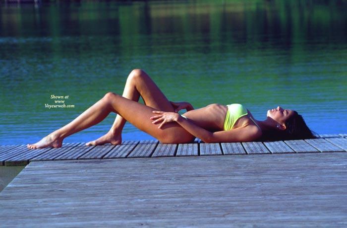 Reclinining Bikini-clad Girl On Dock , Reclinining Bikini-clad Girl On Dock, Lakeside Beauty, Posing On Dock, Black Hair, Yellow Bikini
