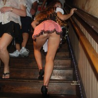 Upskirt View - Shaved Pussy, Upskirt , Pirate Booty, Stair-climbing Skirt Show, Pushing Her Ass Out Below Skirt, Stair Snatch, Pantiless, Event Voyeur, Looking Back Down The Stairs, Peak A Boo Pussy
