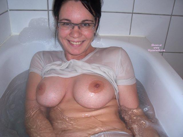 Bathtub - Brunette Hair, Glasses, Huge Tits , Bathtub, Large Boobs, Brunette, In Bath, Looking Straight At Camera, Wet T Shirt, Glasses, Big Boobs
