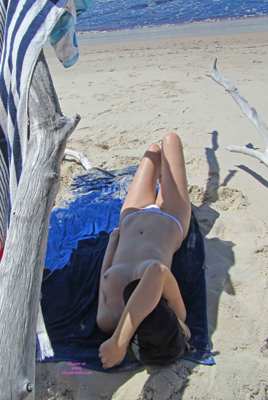 Wife At The Beach , At Our Local Nude Beach, She Got Quite Horny. After An Hour Laying There, She Started To Play With Her Pussy As Guys Walked Passed Her.  Each Guy Stopped To Watch For A While.....