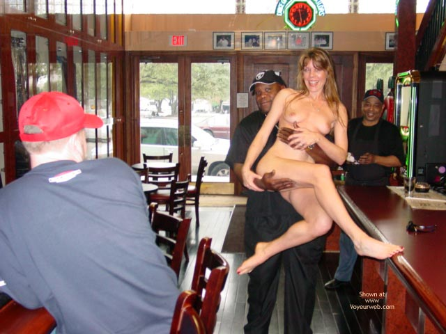 Naked Blond Carry At Bar , Naked Blond Carry At Bar, Naked Blond Girl Drinking With Black Guy, Naked Blond Carried By Black Guy, Naked In Bar, Blonde In A Pub, Interracial Relatonship, Red Nails