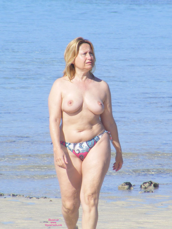 Mature woman topless