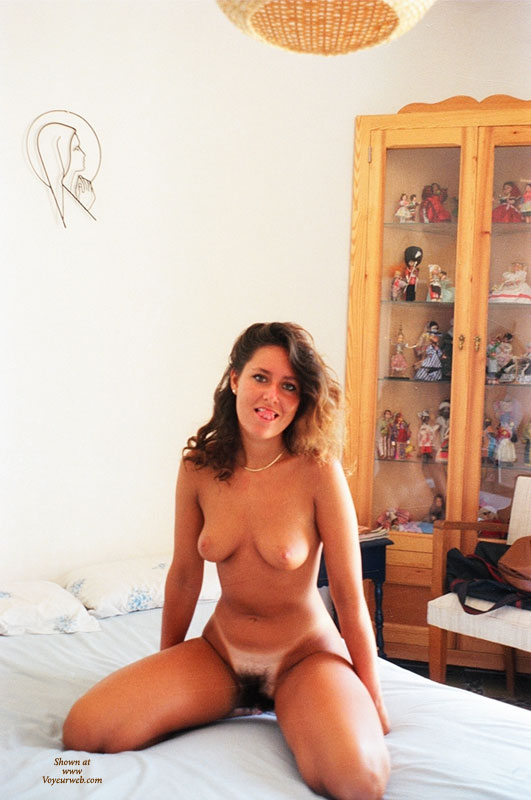 Nude Wife Kneeling On Bed - Dark Hair, Huge Tits, Tan Lines, Nude Amateur, Nude Wife , The Black Forrest, Tongue Out, Mouth Watering Bush, Let's Have A Quickie, Dark Bush, Angle With Full Bush, Big Bush