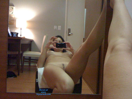 sexy teen naked in bedroom with cell phone