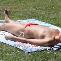 Young Girl Sunbathing Topless , I Hid In A Bush And Got Some Good Shots Of This Blond Topless Goddess. Location: Denmark, Copenhagen, Gunnar Nu Hansens Plads, Fælledparken.