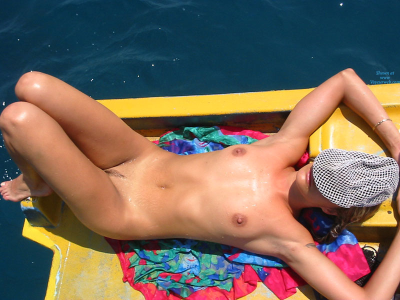 Nude Wife Tanning From Above - Blonde Hair, Landing Strip, Long Hair, Milf, Nude Wife , Nude Milf, Firm Body, Sunning Nude At The Lake, Sexy Trimmed Mons, Small Breast, Nude Sunbather In Open Dinghy, Wet Skin