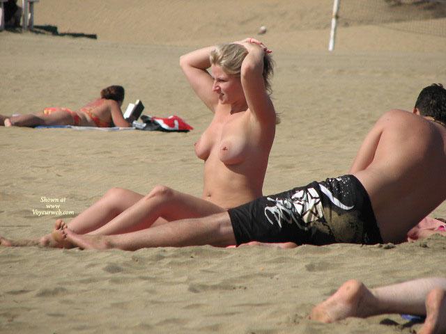 Pierced Nipples Voyeured On Beach - Big Tits, Blonde Hair, Large Breasts, Long Hair, Navel Piercing, Pierced Nipples, Topless Beach, Beach Tits, Beach Voyeur , Double Breast Piercing, Blonde Tanning Breasts, Belly Piercing, Beach Blond, Hands Stuck On Head