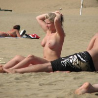 Pierced Nipples Voyeured On Beach - Big Tits, Blonde Hair, Large Breasts, Long Hair, Navel Piercing, Pierced Nipples, Topless Beach, Beach Tits, Beach Voyeur , Double Breast Piercing, Blonde Tanning Breasts, Belly Piercing, Beach Blond, Hands Stuck On Head