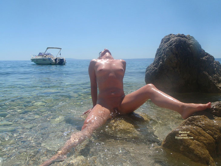 Nude Wife Sitting On Rocky Beach
