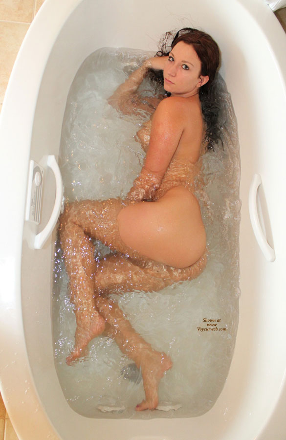 Naked girl in bathtub