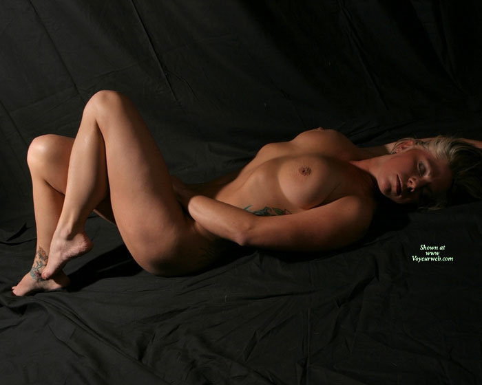 Blonde Lying Naked On Black Photo Backround Canvas - Blonde Hair, Naked Girl, Nude Amateur , Studio Pose With Side Lighting, Statuesque Body, Nude Sexy Blonde, Completely Nude, Nude On Black Sheet Reaching Into Crotch, Full Soft Breasts, Inverted Nipple, Dreaming Girl Naked On Black Sheet, Eyes Closed, Side Tattoo, Toes Pointing, Lying On Back