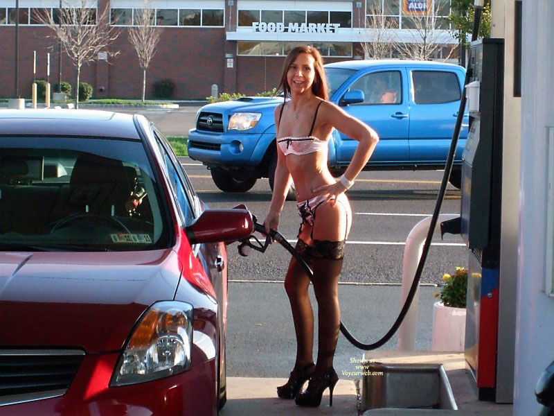 Lady At Gas Station In Lingerie - Heels, Long Legs, Stockings , Pink Bra, Amateur In Lingerie, Pink Shiny Panties, Pink Lingerie, Pink Shiny Lingerie, Lady With A Big Hose Between The Legs., Full Service Station