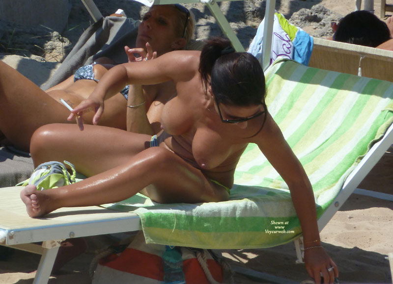 Beach Voyeur - Big Tits, Milf, Beach Voyeur , Well Tanned, Dark Ponytail, Beach Milf, Reaching In Sun Lounger, Large Tits