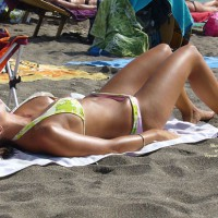 On The Beach , I Was Sunbathing On The Beach When I Saw This Girl Next To Me. I Used A Small Camera So Quality Is Not Excellent. Enjoy!