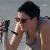 Braless Downblouse - Black Hair, Sunglasses, Beach Voyeur , Grey Top And No Bra, Short Black Hair, Downblouse, Female Amateur Photographer, Nipple Downblouse, Wearing Sunglasses, Amature Photographer, Taking A Photo