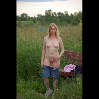 Dara In The Field , My Wife Enjoys The Thrill Of Outdoor Photo Shoots. Here's Some Of Her Stripping In A Field. We Hope You Guys Enjoy These. We'll Post More If This Goes Well.