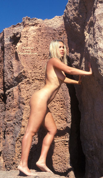 Holding Up Rock Wall - Long Legs, Naked Outdoors, Nude Outdoors , Holding Up Rock Wall, Outdoor Nude, Pushing Rock, Nude Blonde Outdoors, Naked Outdoors, Outdoor Nude Blonde, Allover Tan, Long Legs, Natural Light