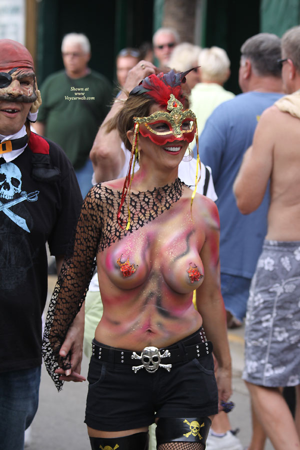 Topless In Public Wearing Body Paint - Brunette Hair, Large Breasts, Topless , Pirates Mate, Pained Tits, Pen Mouth, White Teeth, Festival Voyeur, Nice Smile, Topless With Body Paint, Short Brunette Hair