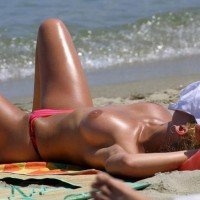 Topless MILF Asleep On Beach - Blonde Hair, Long Legs, Milf, Topless, Beach Voyeur, Sexy Legs , Curly Blonde Hair, Sun Tanning, Big Brown Areola, Pink Bikini Bottom, Bronzed Beauty, Medium Breasts, Topless On The Beach, Long Sexy Legs