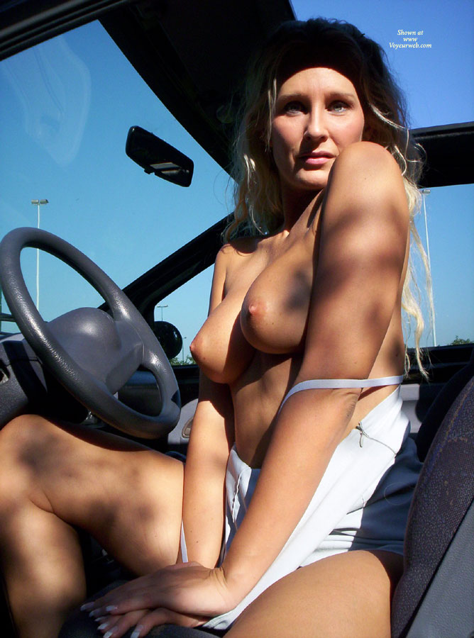 Topless Milf In Drivers Seat - Blonde Hair, Long Hair, Milf, Topless , Dear In The Bright Lights, Sitting Topless In The Car, White Top Pulled Down, Green Eyes, Boobs In The Drivers Seat, Topless In The Car, Topless Blonde, Topless Milf