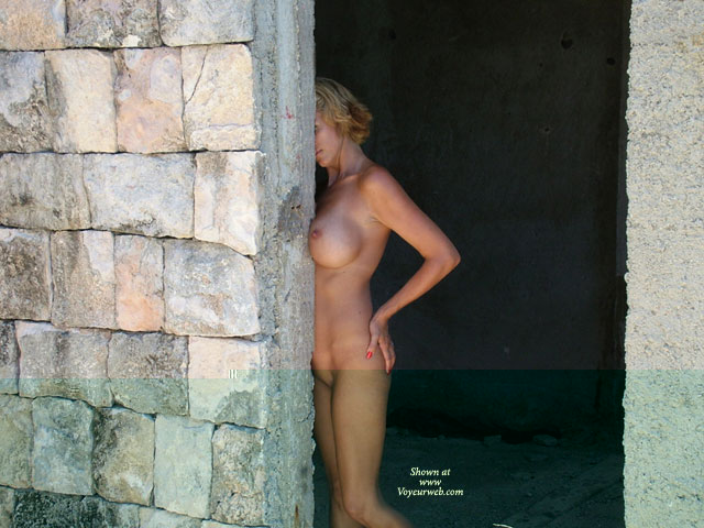 Nude Outdoors Near Rock Wall - Big Tits , Nude Outdoors Near Rock Wall, Boob Job, Big Tits, Blonde Naked, Hiding Face, Nude At Construction