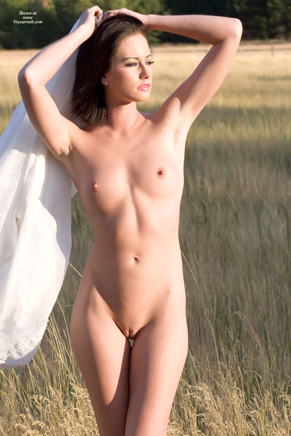 Nude Sexy Woman In Field Dark Hair Erect Nipples Shaved Pussy Small