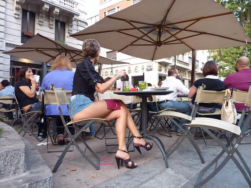 Pantieless Woman In Street Cafe - Exhibitionist, Heels, Long Legs, Sexy Legs , Jeans Skirt, Skirt Pulled Up, Outdoor Cafe Legs, Denim Skirt, Bottomless Girl, Sitting In A Street Cafe, Navy Blue Top, Long Sexy Legs