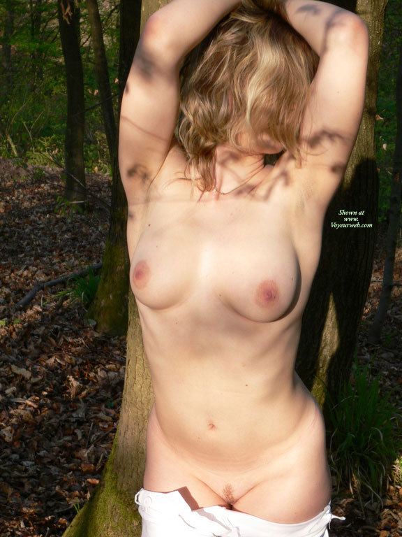 Naked Girl Outside - Landing Strip , Wilderness, Outstretched Hands, Face Hidden, Standing In Nature, White Denim Pants, Outddors Against Tree, In The Sunshine In The Woods, Forest, Standing Naked In The Woods