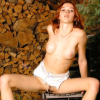 Redhead Outside - Landing Strip , Redhead Outside, Sitting On Chair, Redhead By Woodpile, Peeking Landing Strip