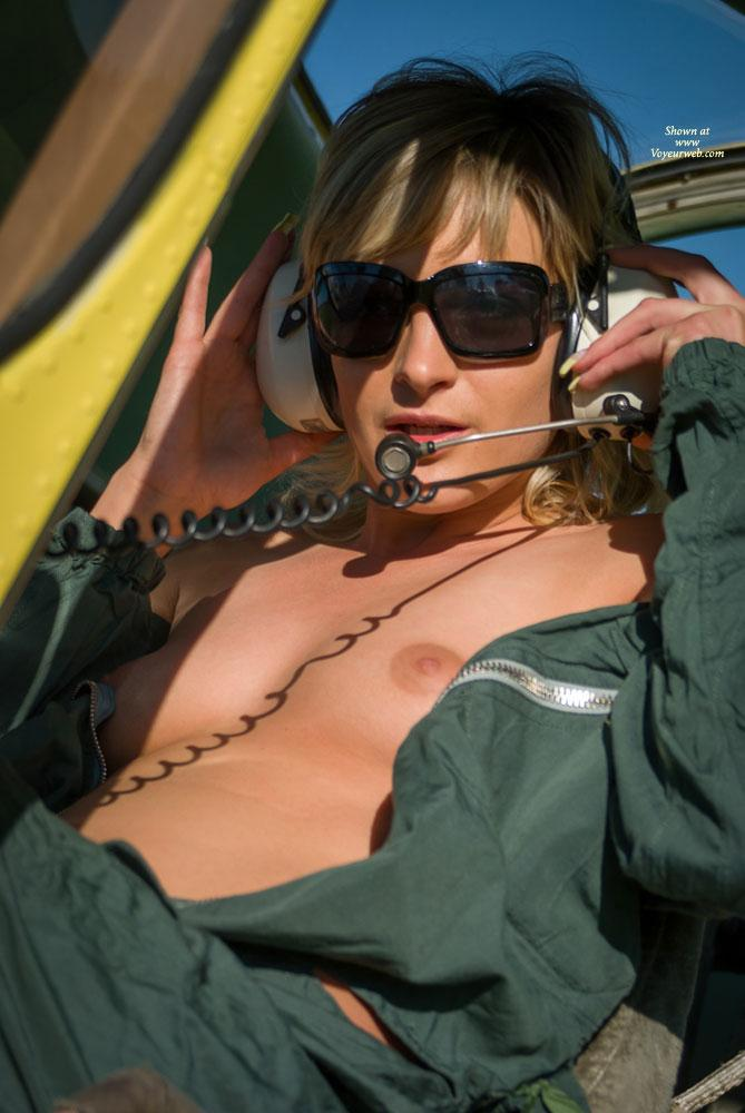Airplane - Blonde Hair, Nude Outdoors, Small Tits, Dressed , Some Guys Asked For Another Shooting With Stephanie At The Airstrip. Enjoy Her Cute Body And Smiling Face.