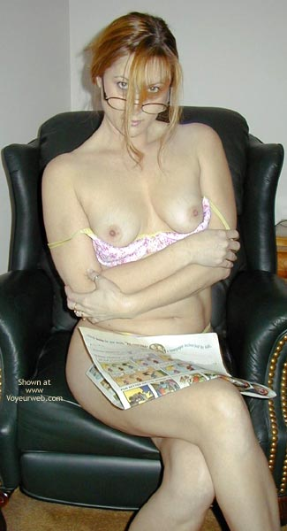Blonde Seductress On Black Chair , Blonde Seductress On Black Chair, Topless Blonde In Black Chair, Topless With The Newspaper, Pink Bra
