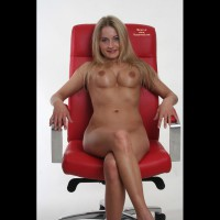 *ch Karin On A Red Chair