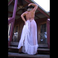 Black Hat - Rear View, Skirt , Black Hat, White Seethrough Long Skirt, Seethough Skirt, Cowgirl, Cowboy Boots, Rear Shot