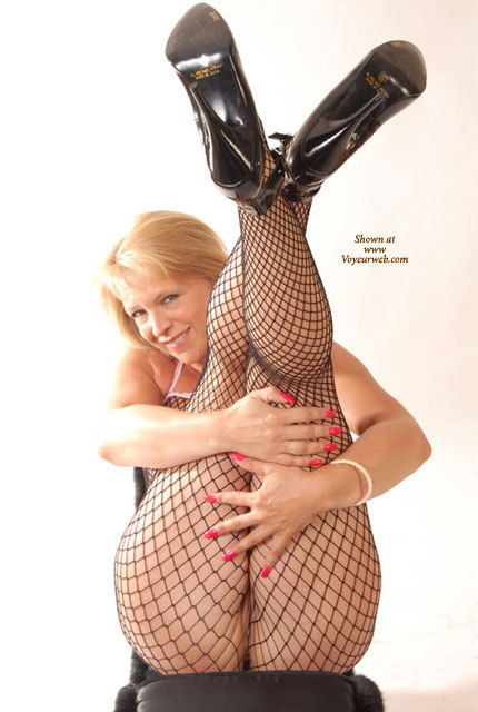 Holding Legs Up In Mesh Pantyhose - Black Hair, Blonde Hair, Round Ass , Firm Round Ass, Red Fingernails, Pussy In Net, Black Fishnet Bodysuit, Black Heels