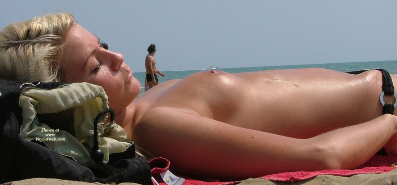 Nice blonde girl topless on the beach