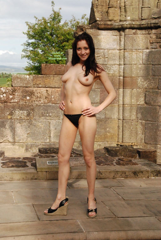Topless Brunette Posing Outdoors - Black Hair, Brunette Hair, Dark Hair, Long Hair, Natural Tits, Perfect Tits, Topless, Naked Girl, Nude Amateur , Topless Outdoor In Front Of Old Stone Wall, Nude Outdoors, Smiling Outside, Tear Drop Tits, Black Wedge Heels, Standing Tall And Straight, Dark Long Hair, Black Wedge Sandals, Black And Tan Heeled Sandals, Standing In Nature, Topless In Panties Posing By Ruins, Staning Tall, Medium Breasts, Black Panties, Teardrop Tits, Black G- String, Topless Brunette With Black Panty