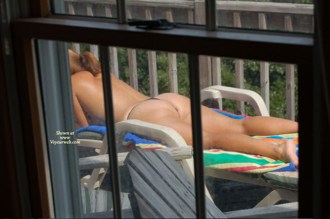 Nc Beach House , I Caught This Lady Tanning One Saturday Afternoon When I Was Checking Rental Houses Damages. Turnout This Family Had House Rented For Two Weeks And Therefore Had Not Checked Out. Only Had Time To Take A Few Shots Because Her Husband Was In The Shower In The Master Suite.