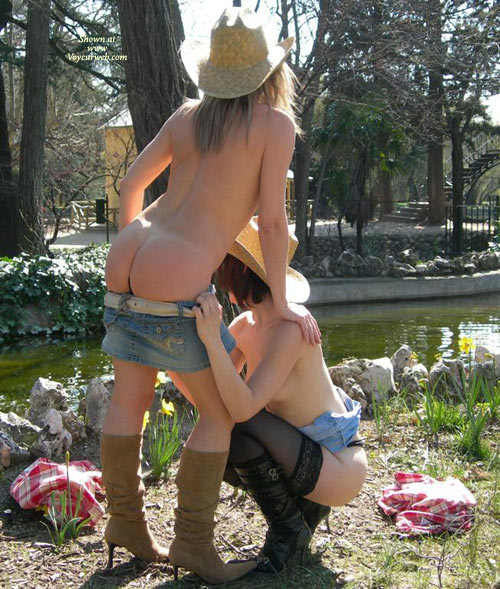 Two Cowgirls Stripping - Stockings , Cowboy Boots, Denim Mini-skirts, High Heel Boots, Stripping Each Other, Two At A Time, Leaning On Another Girl, Straw Cowboy Hats, Kneeling In Public, Two Girls Posing In Public, Outdoor Cowgirl Twins, Cow Girls In A Park