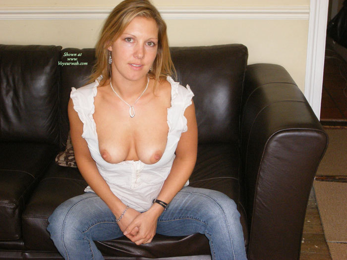 Blonde Sitting On A Black Couch In Jeans With Boobs Out The Top Of Her White Shirt - Blonde Hair, Brown Eyes, Brown Hair, Natural Tits, Perfect Tits , Medium Natural Tits, Puled Down White Blouse, Blonde Hair, Brown Eyes, Medium Boobs, Beautiful Blonde Showing Boobs, Classic At Home, Blue Jeans, Sitting On A Couch, Tits Hanging Over Low-cut Blouse, White Shirt Pulled Down And Medium Boobs Out